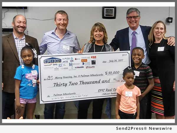 EPIC presents check to Mercy Housing Lakefront