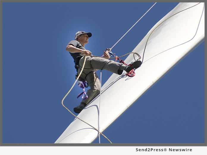 Mark Richey cleaning wind turbine