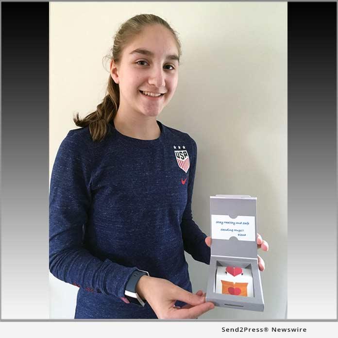 Elena Barrett holding a HuggyBox