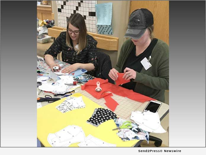 Sara Hiatt and Keri Barton work together on mask templates