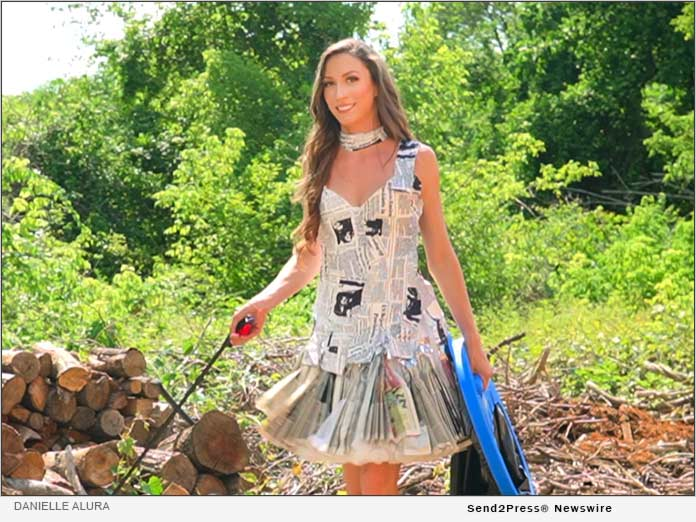 Danielle Alura wears outfit made out of newspaper