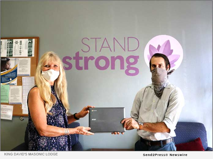 Andrew Brown Delivers laptops to StandStrong