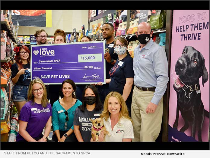 Staff from Petco and the Sacramento SPCA gathered for the check presentation at the Folsom retail store