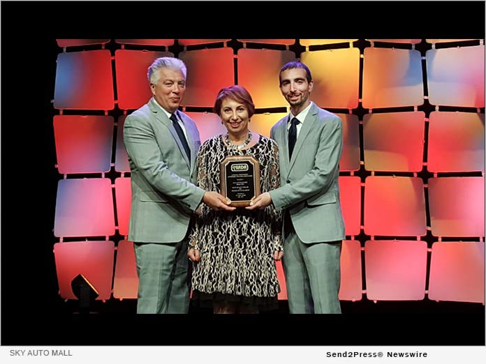 Left to right: Igor, Yelena, Alex Tovstanovsky on stage at the NIADA Dealer of the year awards ceremony, Las Vegas